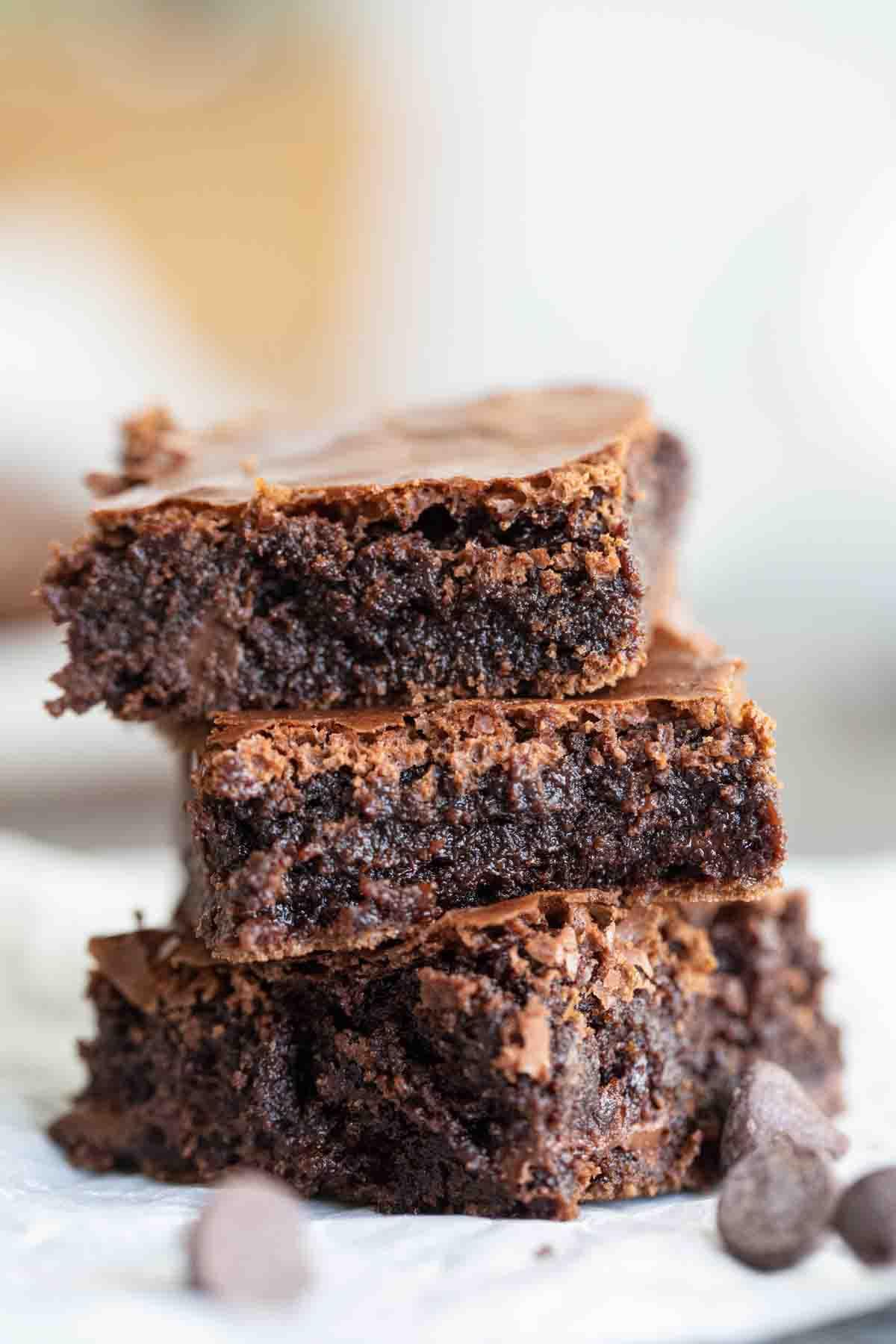 three fudgy brownies stacked