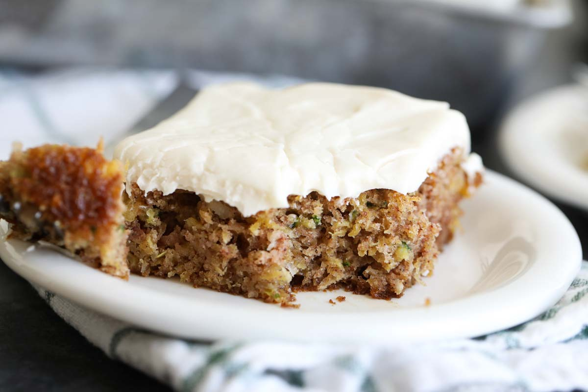 slice of zucchini cake with a bite taken from it