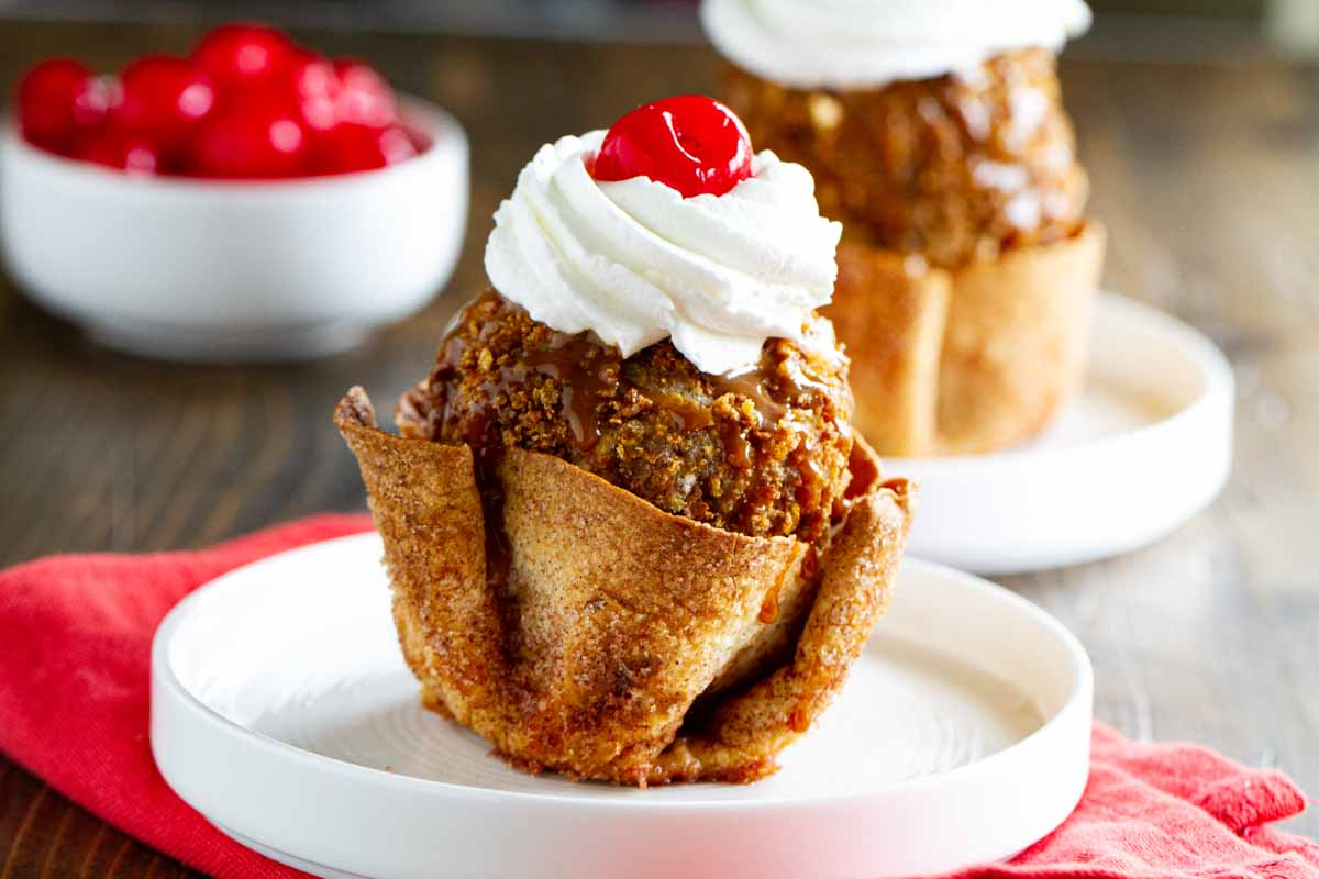 Fried ice cream in a cinnamon sugar tortilla bowl topped with whipped cream