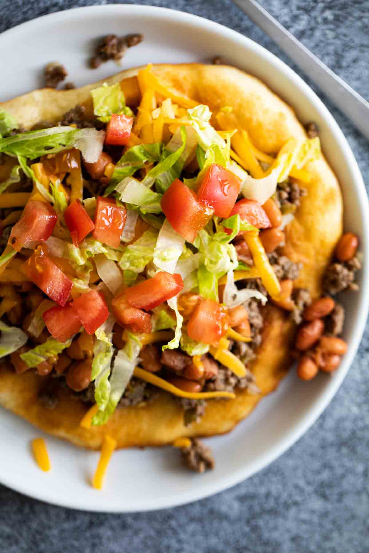 overhead view of navajo taco topped with toppings