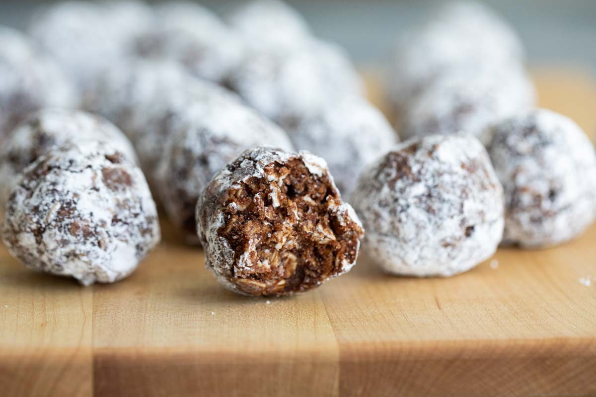 No bake peanut butter oatmeal balls with a bite taken from one