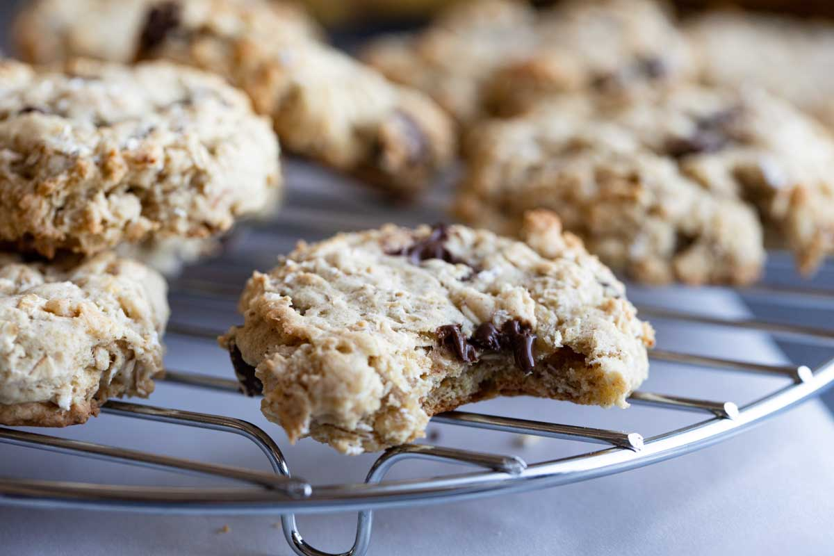 Banana Oatmeal Cookies on a cooling rack with bite taken from one cookie