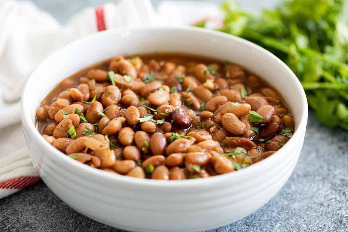 white bowl of instant pot pinto beans