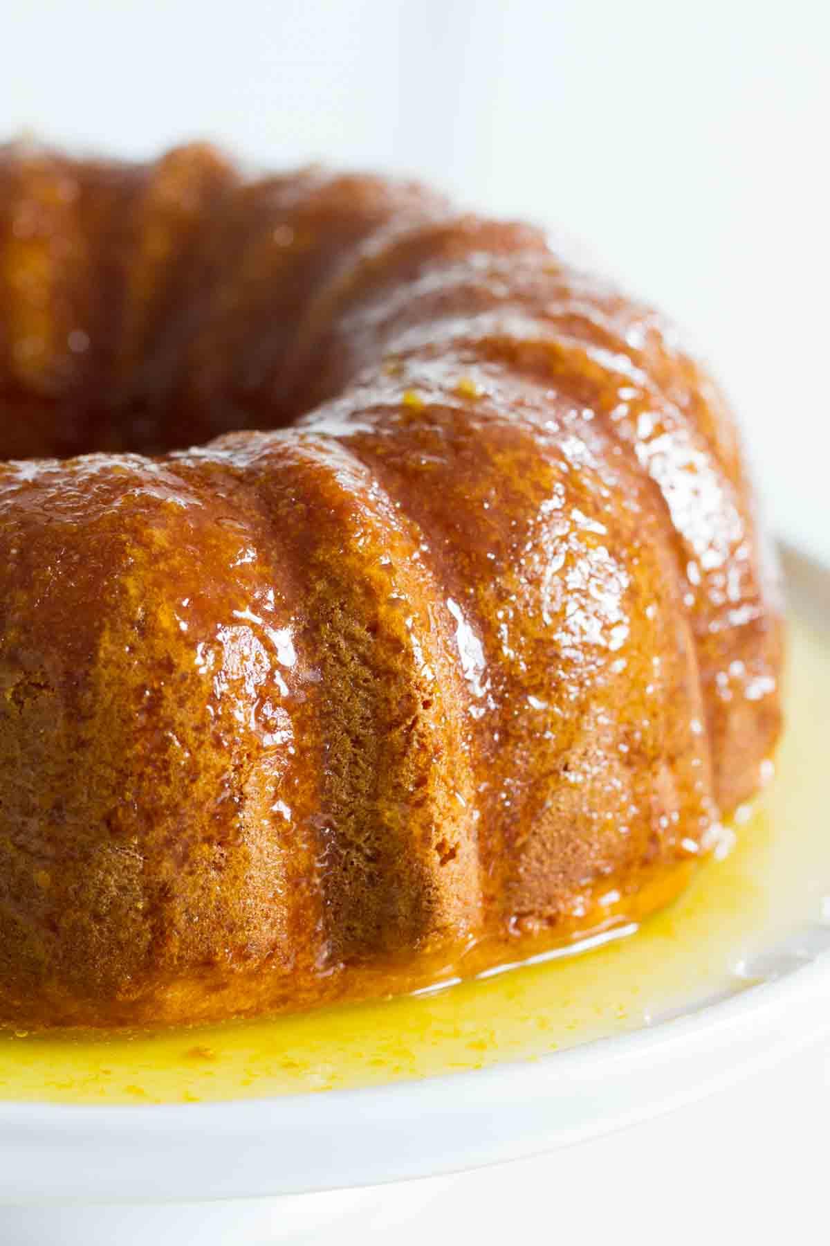 orange bundt cake with orange glaze on a platter