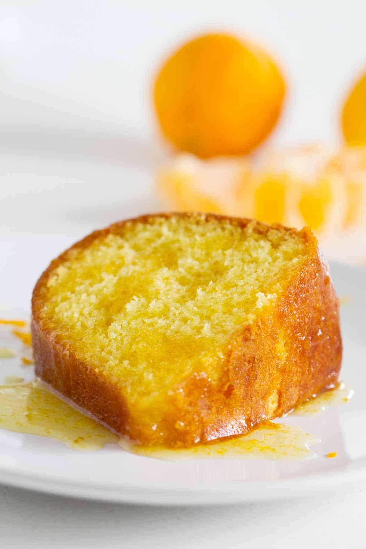 slice of glazed orange bundt cake on a plate